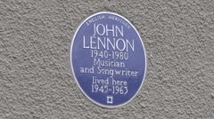 Blue plaque outside the childhood home of John Lennon in Liverpool, UK. Stock Footage