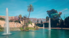 Fountain panorama in park de la ciutadella sun light 4k time lapse spain Stock Footage