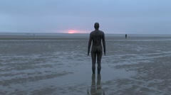 'Another Place' by Antony Gormley on Crosby Beach, Liverpool, UK. Stock Footage