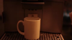 Coffee dispensed from a machine Stock Footage