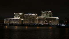 Moscow evening winter Stalinist building with illuminated reflected in the water Stock Footage