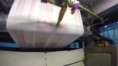 4k Paper (roll of paper) for a printing press newspaper production line. UHD Stock Footage