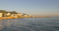 Sun light mediterranean sea sitges coast hotels 4k spain Stock Footage