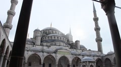 Blue Mosque courtyard, day, snowing - Istanbul Stock Footage