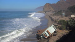 A house along the Malibu coastline collapses into the sea after a major storm Stock Footage