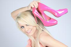Addicted from high heels woman holding her new shoes - stock photo