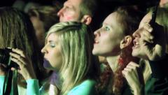 Young girls singing and filming at a concert Stock Footage