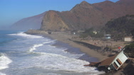 Stock Video Footage of A house along the Malibu coastline collapses into the sea after a major storm