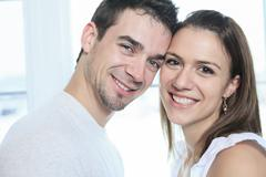 Stock Photo of A couple having great time close to the window