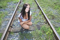A fashion woman on the railroad train - stock photo