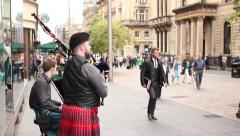 Bagpipe street players with kilt in Scotland Stock Footage