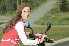 happy girl riding scooter enjoy summer vacation - stock photo