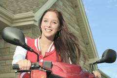 Happy girl riding scooter enjoy summer vacation Stock Photos