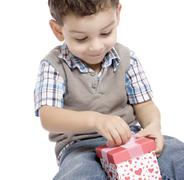 The little boy receives a beautiful gift - stock photo