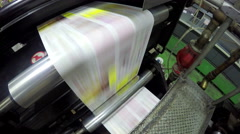 4k Close-up of printing mechanism rolling freshly typed newspaper. UHD stock Stock Footage