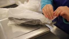 Fish shop. weighing in the balance of frozen fish Stock Footage
