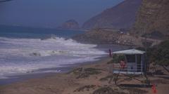 A lifeguard station along the Malibu coast during a big storm surge. - stock footage