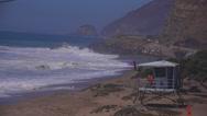 Stock Video Footage of A lifeguard station along the Malibu coast during a big storm surge.