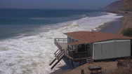 Stock Video Footage of A building along the Malibu coastline collapses into the sea after a major storm