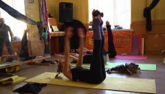 Young girl hard training in circus acrobatic troupe Stock Footage