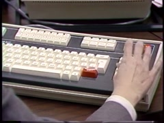 Hands typing on old 1980's computer keyboard - stock footage