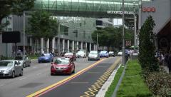 Zoom, Traffic, cars drive along Orchard Road, Singapore Stock Footage