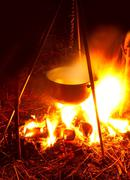Saucepan on campfires Stock Photos