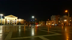 Pedestrians and traffic pass by on the Heroes Square in Budapest at night - stock footage