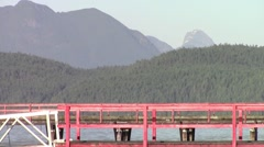 Public Pier FG, Coastal Mountains BG, Cortes Island, British Columbia, Canada Stock Footage