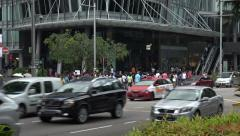 Zoom, crowd of people cross Orchard Road, traffic passes, Singapore Stock Footage