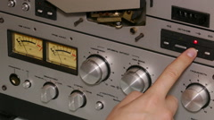 Hand man operates reel tape recorder Stock Footage