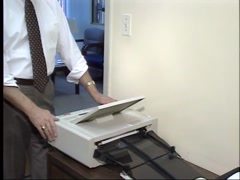 Late 1980's or early 1990's fax machine in use archival footage - stock footage