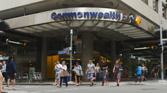 Slow motion pedestrians outside Commonwealth bank Stock Footage
