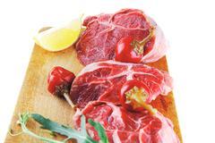 fresh beef medallion on wood - stock photo