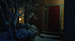 Front door of house on a winter night - stock footage