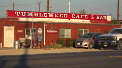 The lonely Tumbleweed Cafe truck stop bar and cafe along a remote desert Stock Footage