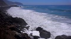 Large waves crash along a Southern California beach near Malibu. Stock Footage
