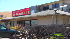 Establishing shot of a small truck stop restaurant along an American highway. Stock Footage