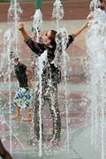 Fully Clothed Man Gets Triumphantly Soaked Standing In Atlanta Fountain Stock Photos