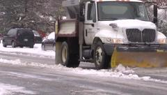 Plow on snowy streets Stock Footage