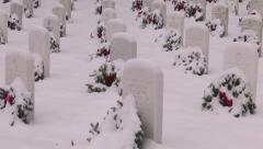 Zoom out from headstones Arlington National Cemetery sign in snow Stock Footage