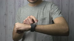 4K Man Using Smartwatch On his Wrist Stock Footage