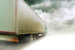 Speeding truck on Snowy road Stock Illustration