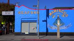 Establishing shot of a bright blue seafood restaurant. Stock Footage