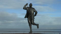 The Eric Morecambe statue on the seafront of Morecambe, Lancashire, UK. Stock Footage