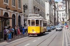Old-fashioned yellow tram Stock Photos