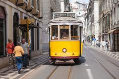 Old-fashioned yellow tram - stock photo