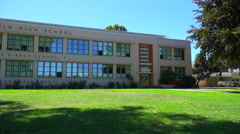 Establishing pan shot of a typical American public school. Stock Footage