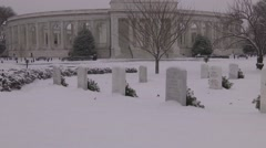 Zoom out on Arlington National Cemetery memorial with snow Stock Footage