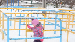 Girl Snake Run on Playground at Winter Day Stock Footage